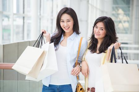 shopping scene: Happy young Asian women shopping.