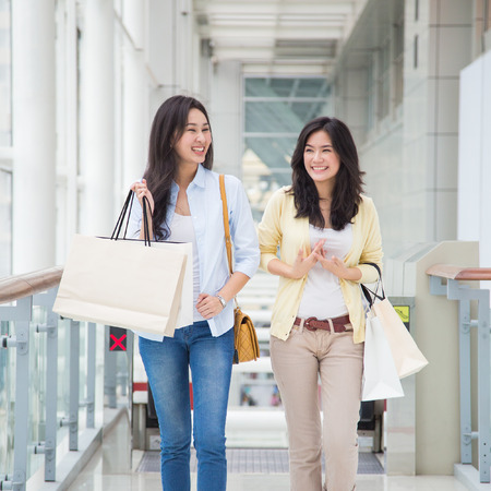 chinese woman: Happy young Asian women shopping.