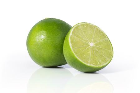 Limes on white background Stock Photo