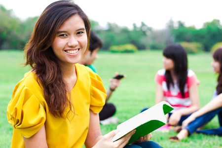 college student: Young people hanging out in the park. Stock Photo