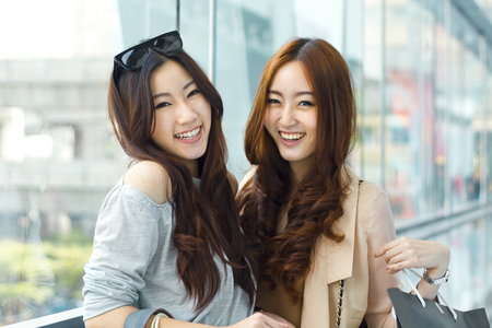 Happy young Asian women shopping.