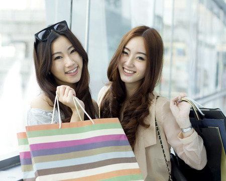 japanese ethnicity: Happy young Asian women shopping.