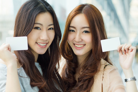 shopping card: Happy young Asian women shopping.