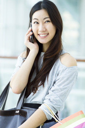 chinese ethnicity: Happy young woman on the phone