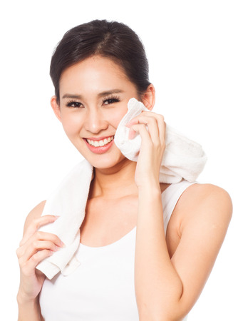 body concern: Young woman holding towel and smiling