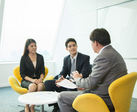 asian guy: Business people in meeting room