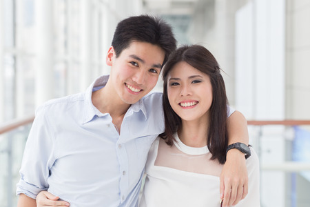 A happy young asian couple Imagens