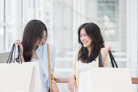 Two asian women enjoy shopping