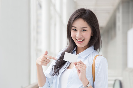 Asian woman shopping with credit card