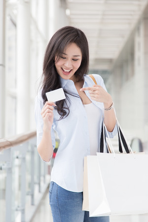 Asian woman shopping with credit card photo