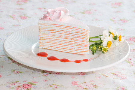 mille: Crepe cake with strawberry sauce on dish