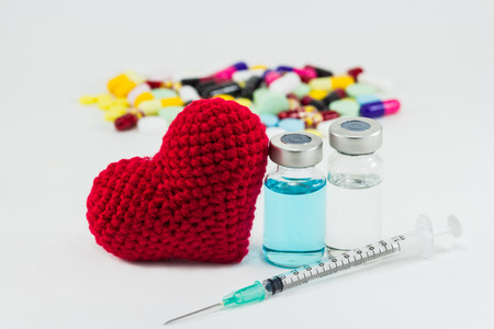 palliative: medicine, vaccine and big red heart Stock Photo
