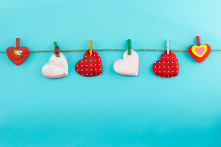 felicitation: Cotton hearts hanging over blue  background