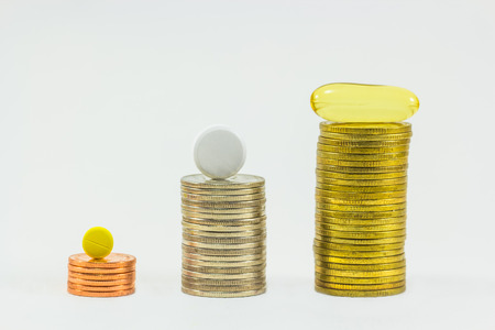 inhibit: Medicine and money on white background. Expensive bill. Finance concept of pharmacy business. Stock Photo