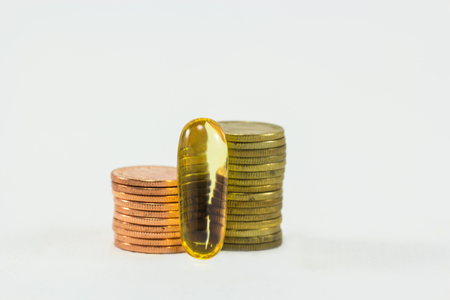 palliative: Medicine and money on white background. Expensive bill. Finance concept of pharmacy business. Stock Photo