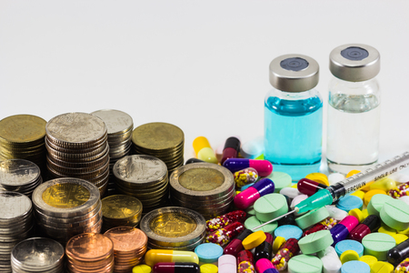 salve: Medicine with money and syringe on white background. Expensive bill. Finance concept of pharmacy business. Stock Photo