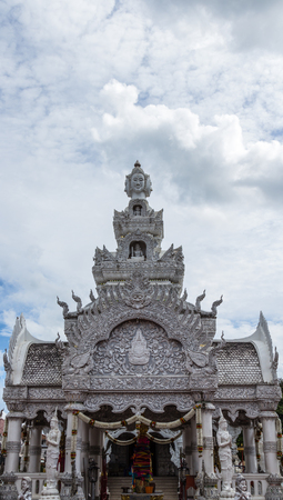 unruffled: Traditional Thai style art of stucco in  The City Pillar  Shrine of Nan in Thailand Stock Photo