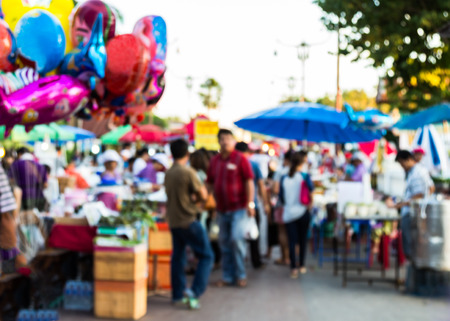 vend: abstract blur background of people shopping at market fair
