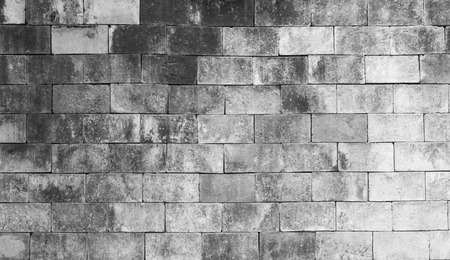 unyielding: background of old brick texture on black and white