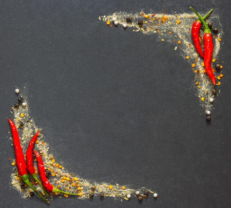 peper: chili, peper and spices on black stone with copyspace Stock Photo