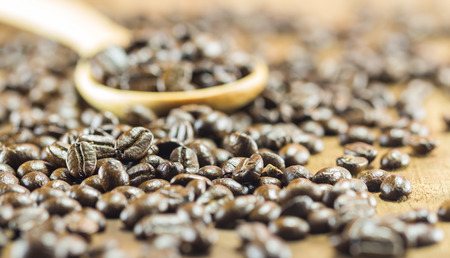 repast: Coffee Beans  texture  on the wood background,selective focus,worm toning Stock Photo