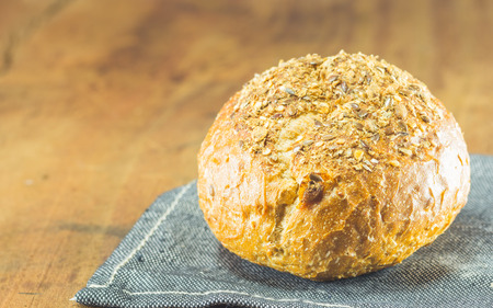 repast: the fresh bread  on the wood background, warm toning, selective focus