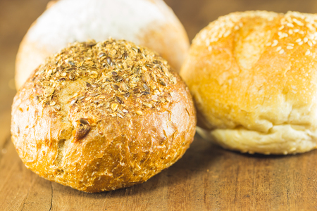 gluttonous: the fresh bread  on the wood background, warm toning, selective focus
