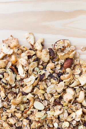 gluttonous: Pile of granola cereal on the wood background