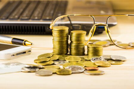 chink: selective focus of golden coins and the accessory of business,warm toning