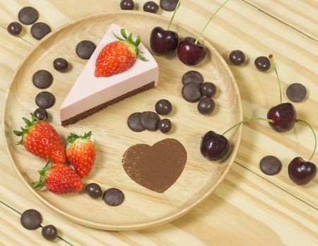 lambent: selective focus of strawberry chocolate cheese cakeon wood background with strawberry and chocolate
