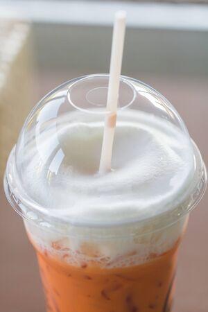 repast: selective focus of milk tea withmilk foam, macro