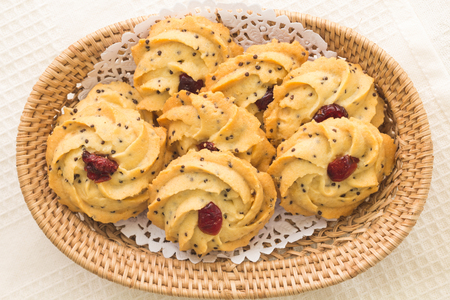 lucid: pile of cookies with dry cranberry and sesame
