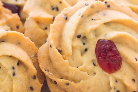 repast: pile of cookies with dry cranberry and sesame
