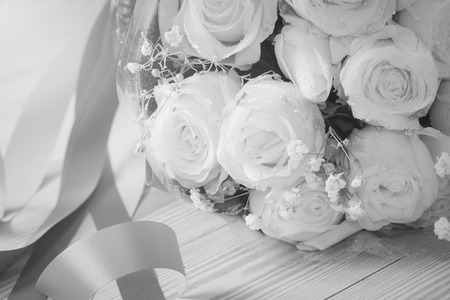 lambent: close up of bouquet of fresh roseson black and white,selective focus
