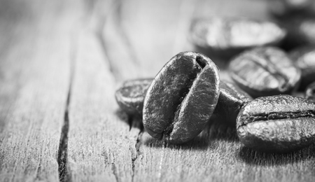 gluttonous: Coffee Beans  texture  on black and white on the wood background,selective focus