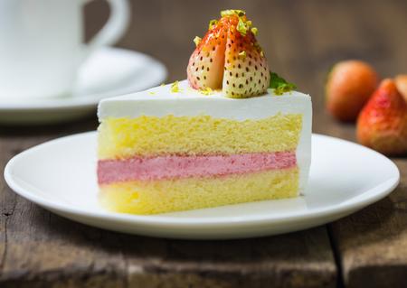 lucid: close up of strawberry cream cake on white on the wood background