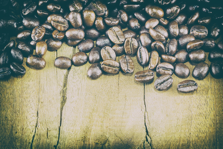 crave: Coffee Beans  texture  on the wood background,selective focus,worm toning Stock Photo