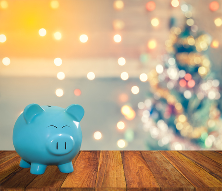 lucid: blue pig bank with Christmas background,  money and saving for celebration concept. Stock Photo