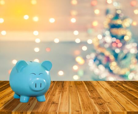 blue pig bank with Christmas background,  money and saving for celebration concept. Stock Photo