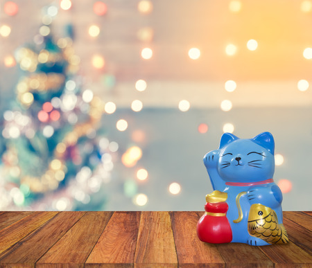 lambent: lucky cat bank with Christmas background,  time to start to saving for keep money for celebration. Stock Photo