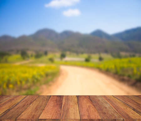lucid: old wood texture with  blur mountain and field background