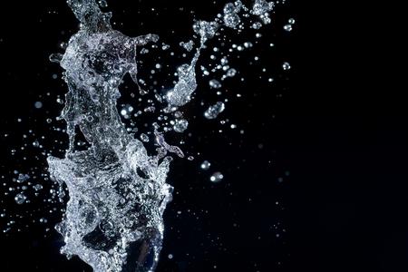 Water splash on black background Stock Photo