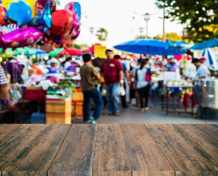lucid: old wood texture with blurred  people walk in the fair background Stock Photo