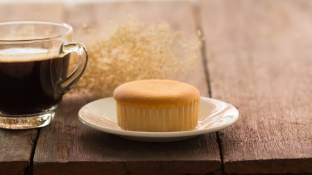 lucid: butter cake with hot coffee cup on the table