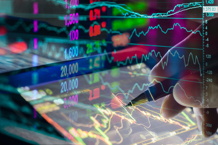 accounting design: Financial data on a monitor,candle stick graph of stock market , stock market data on LED display concept