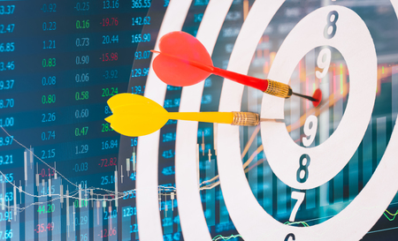 marketing target: Arrows on dart board with stock market graph background mean the goal and success. Suitable for all artwork design about marketing target and business which want to relate for victory concept.