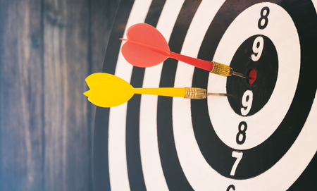 target dart with target arrows and dartboard is the target and goal,abstract background to target marketing, target business and target to victory concept .