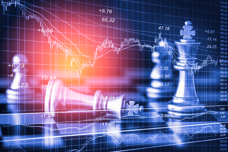 double game: Business game on digital stock market financial and chess background. Digital business and stock market financial on LED. Double exposure chess business strategy and digital stock market financial. Stock Photo