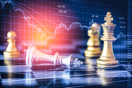 Business game on digital stock market financial and chess background. Digital business and stock market financial on LED. Double exposure chess business strategy and digital stock market financial. Imagens