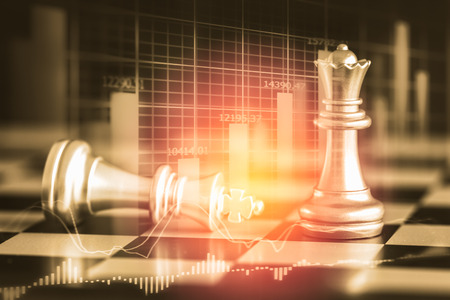 digital asset management: Business game on digital stock market financial and chess background. Digital business and stock market financial on LED. Double exposure chess business strategy and digital stock market financial. Stock Photo